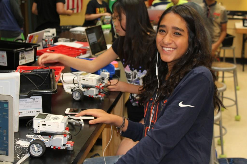 Engineering students program lego robots again.