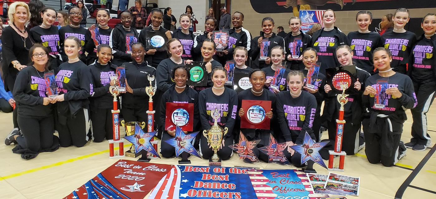 The Cherokee Charmers pose with all of their awards at the North Texas Regional Competition