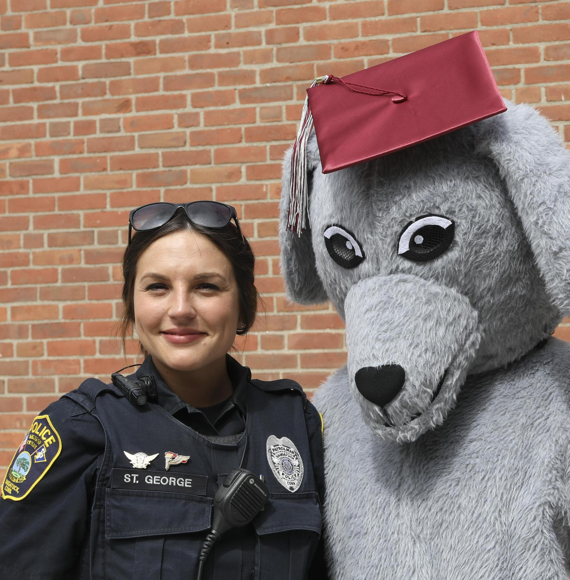Officer St. George with greyhound mascot
