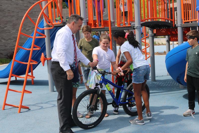 Mr. Manuel with kids on a bike