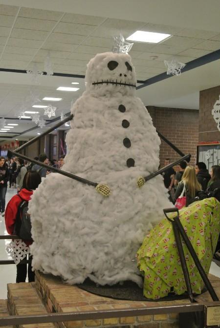 miner statue dressed as skeleton snowman