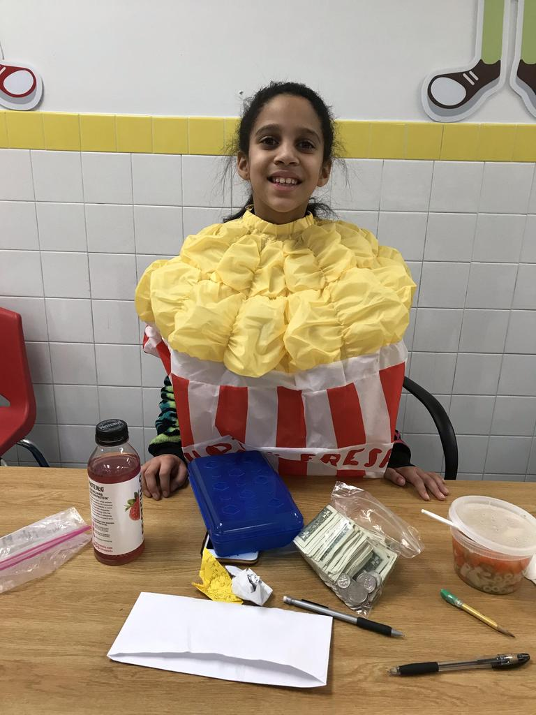 little girl dressed as tub of popcorn