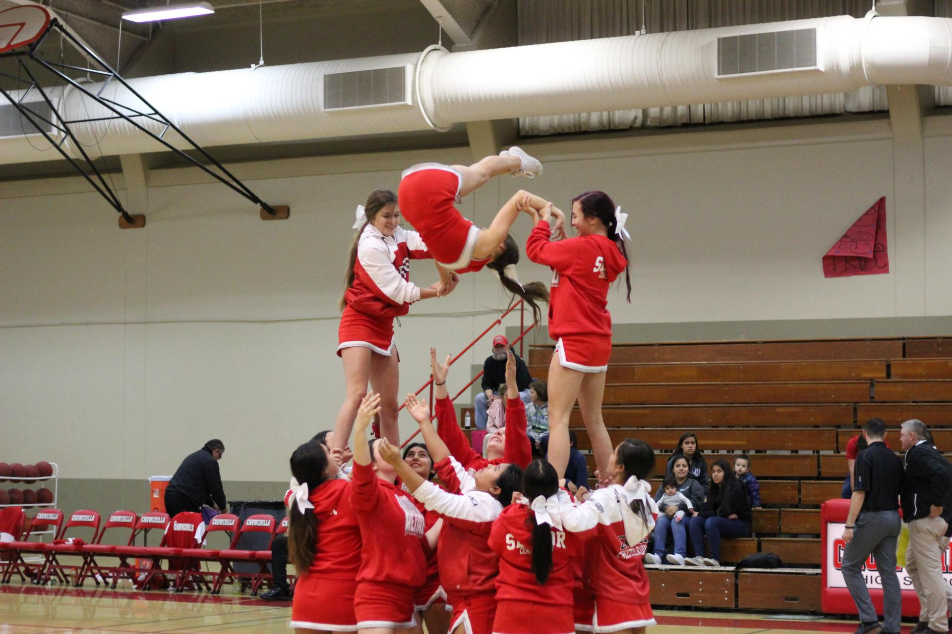 Cheer at basketball against Caruthers.