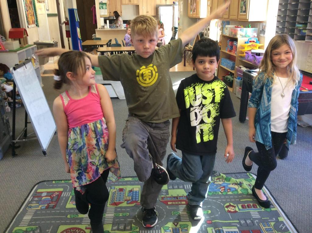 children standing on one leg