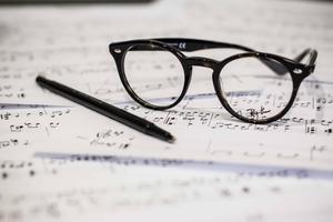 glasses, pencil, paper