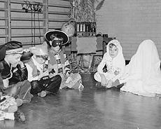 Halloween trick or treaters in costume, circa 1950