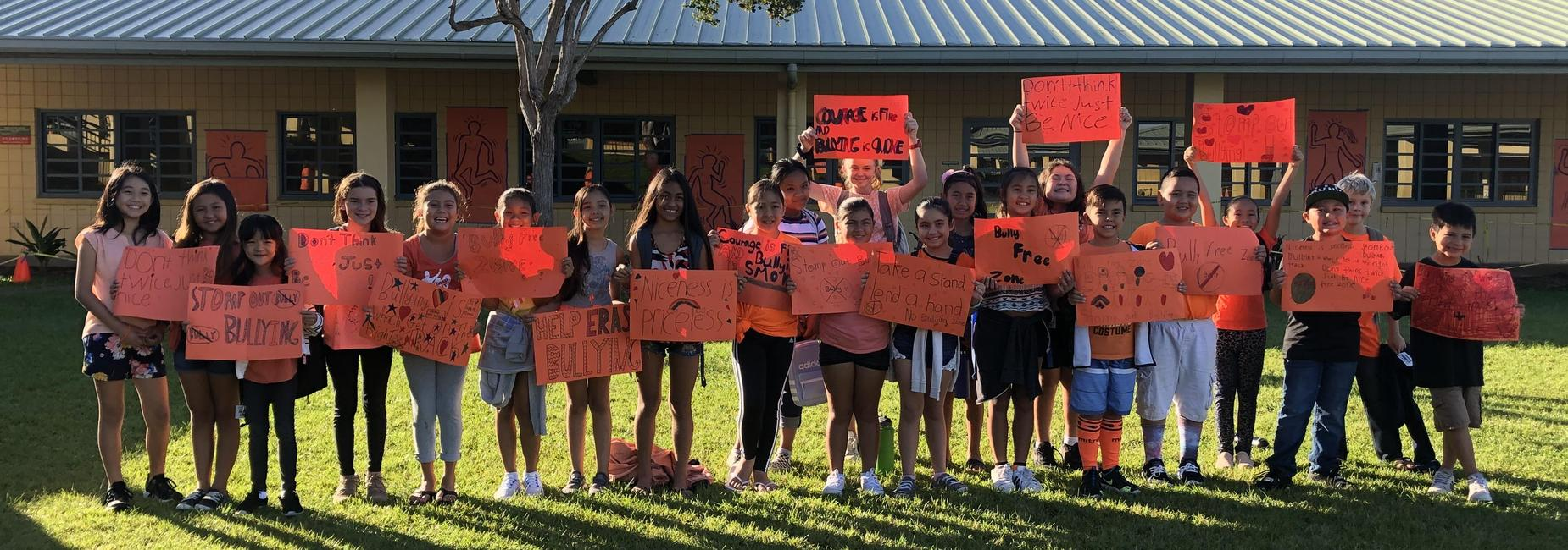 Picture of students holding Unity Day signs