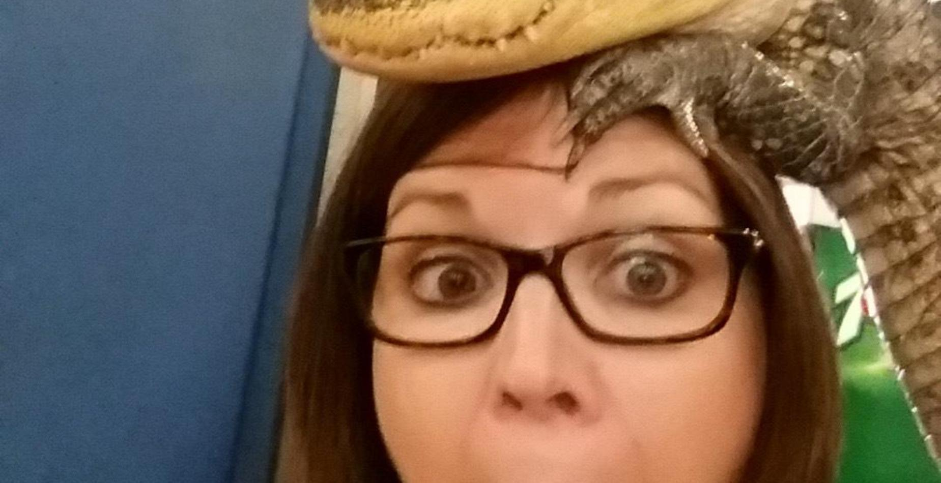 Our principal with a crocodile on her head.