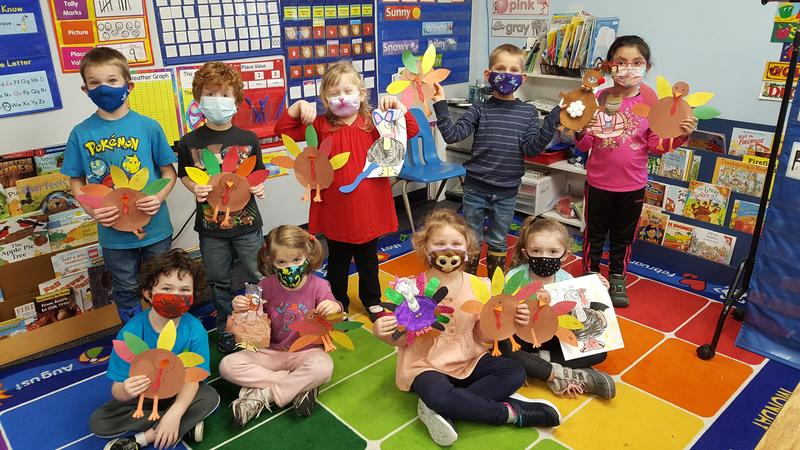 Kindergarten students with their turkey art