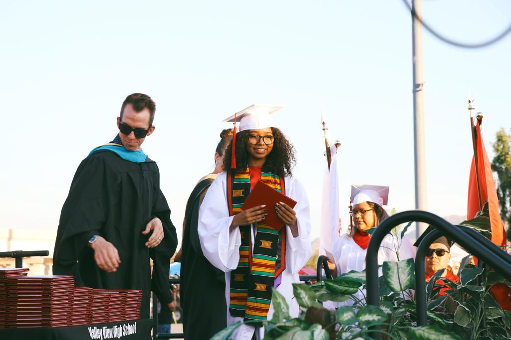 Class of 2019 graduate walks onstage to get diploma