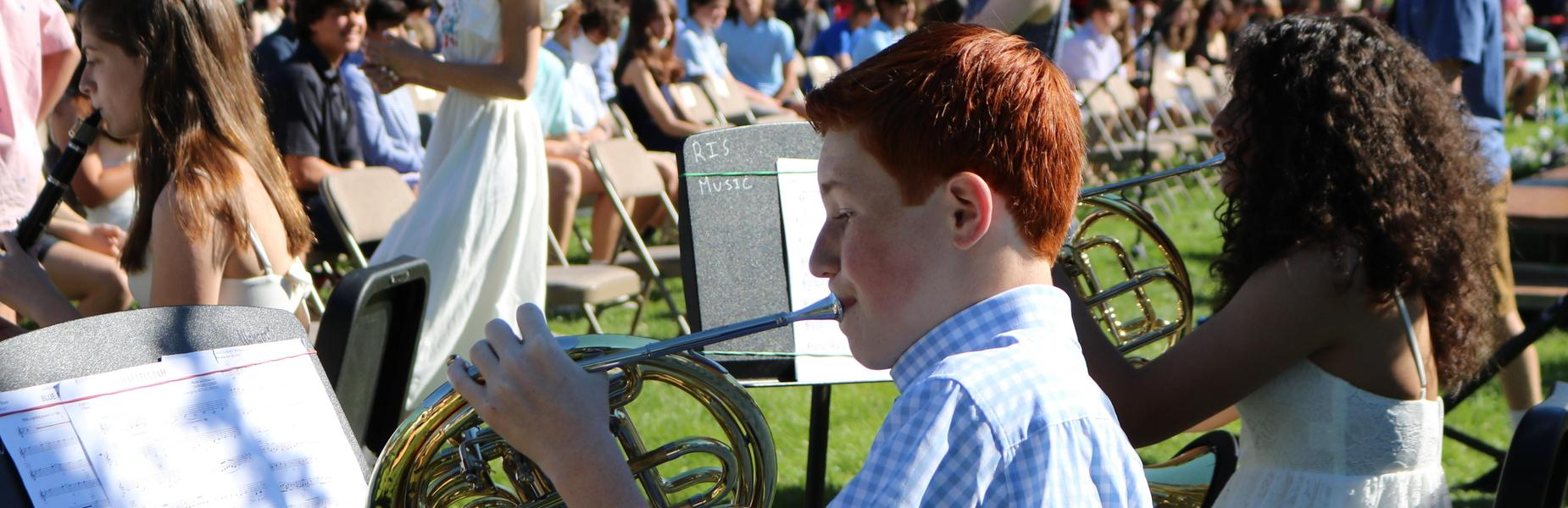 Photo of 8th grade french horn players during 8th grade promotion ceremony