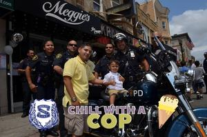 chill with a cop photo of child & dad on top of motorcycle