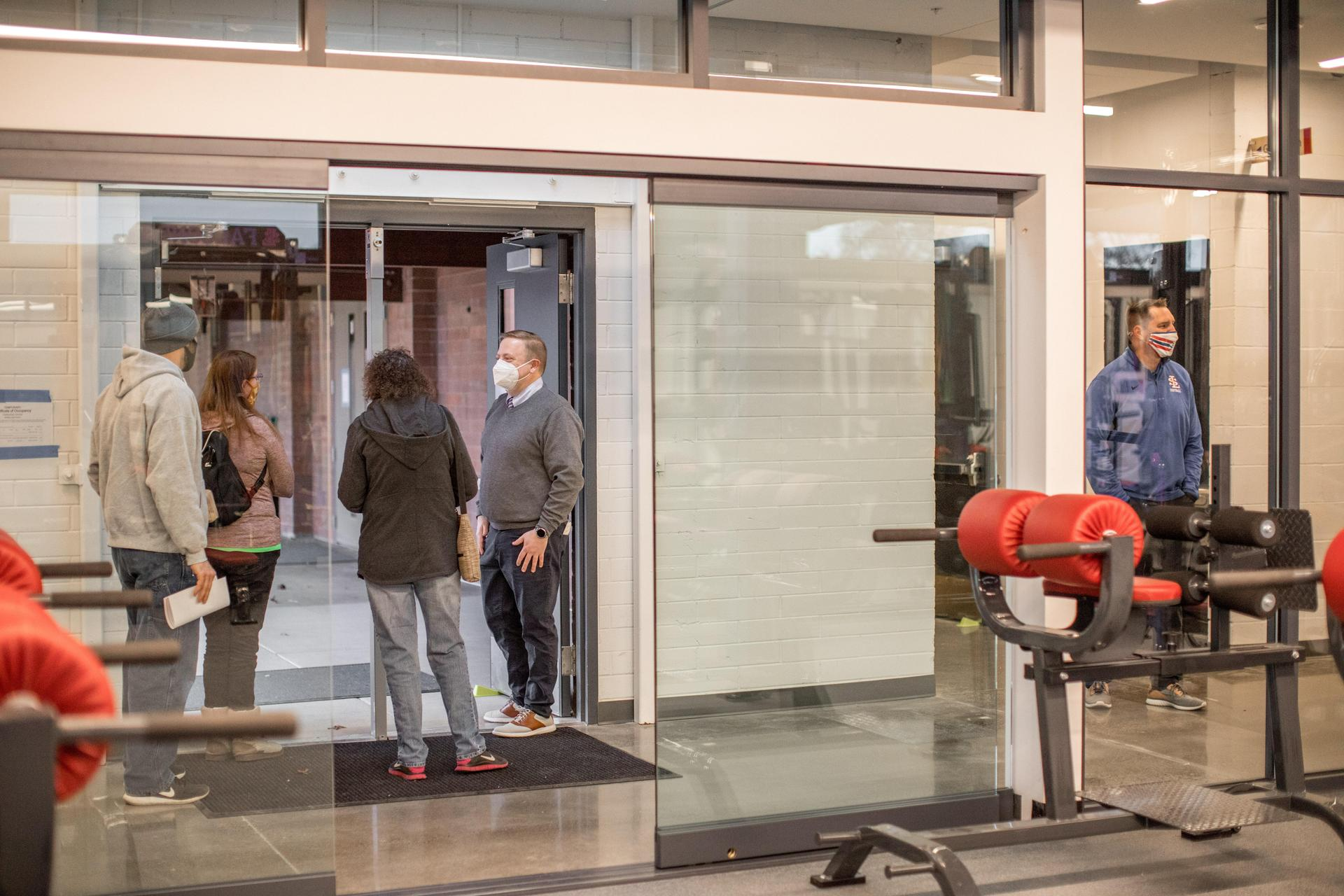 people touring the inside of the fitness center