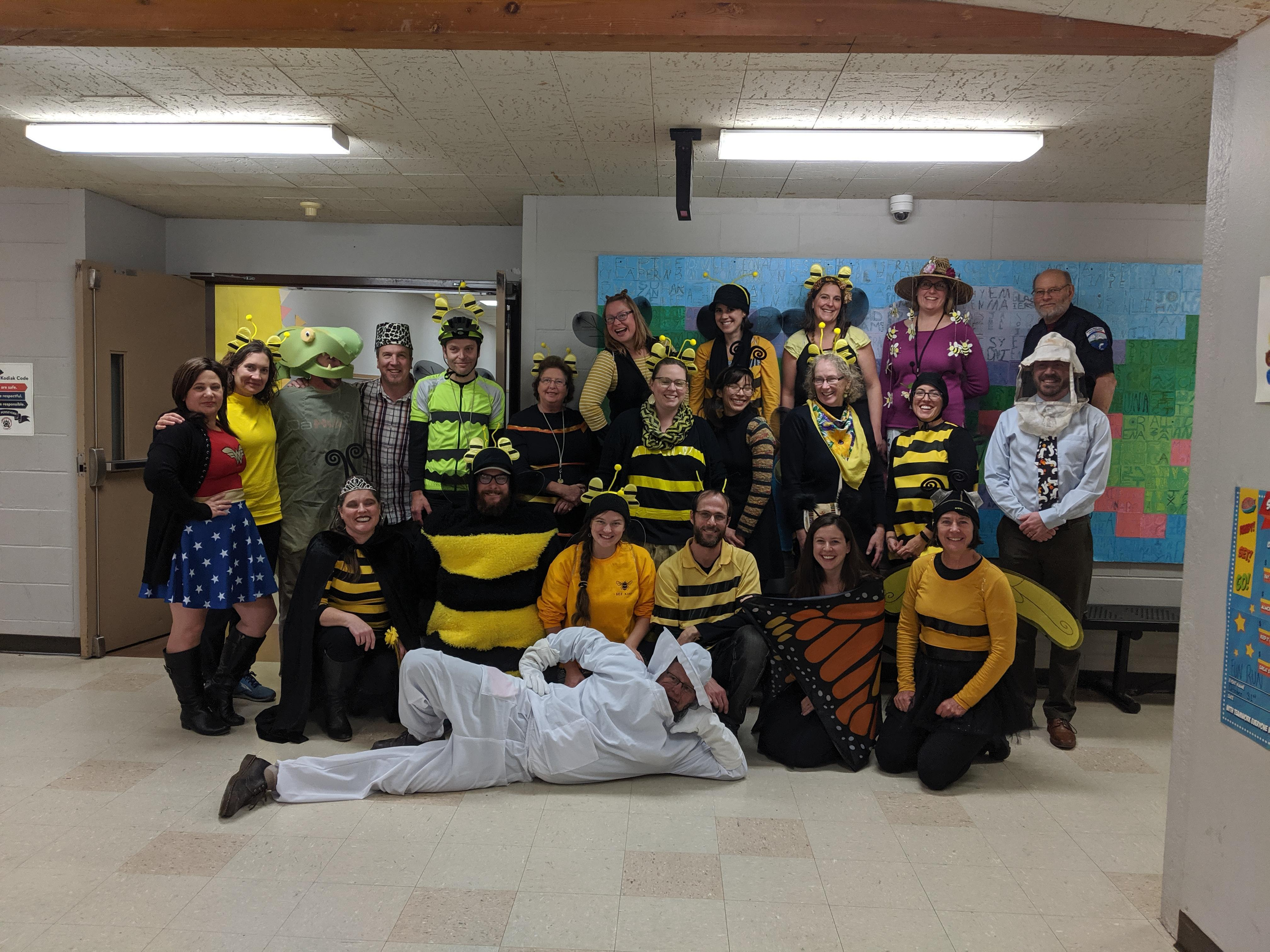 teachers in bee costume