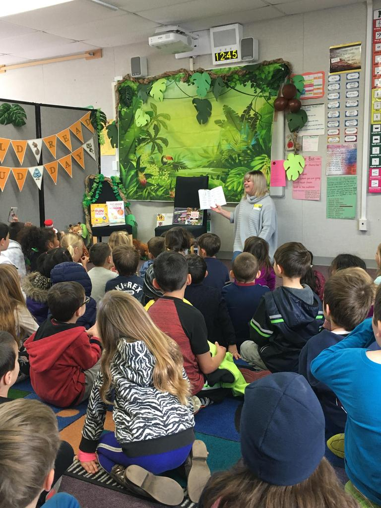 reader reads to students