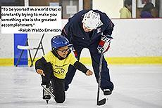 "Image of a young blind student learning about ice hockey.""To be yourself in a world that is constantly trying to make you something else is the greatest accomplishment."" - Ralph Waldo Emerson"