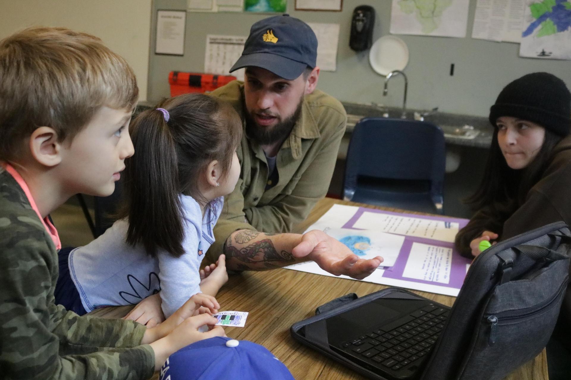 A teacher talks to students