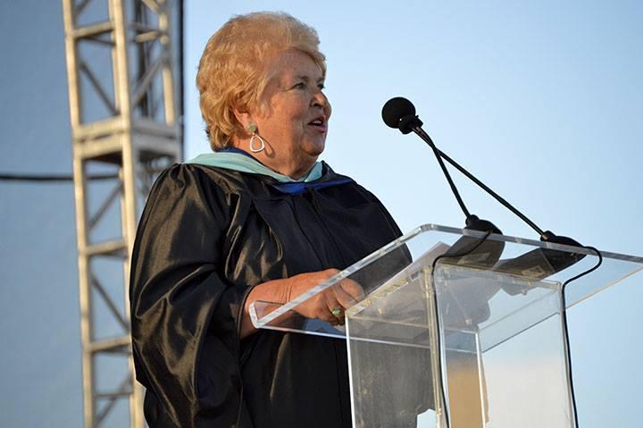 A board member speaks at graduation