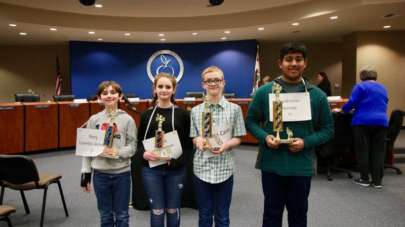 Yudhister Kumar, Mason Carey, Rory Jensen, and Natalie Jensen with their Spelling Bee Awards.