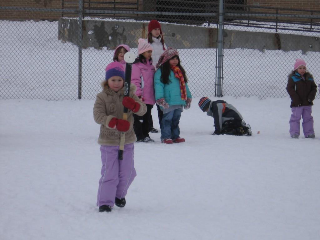 kids playing outside in snow at recess