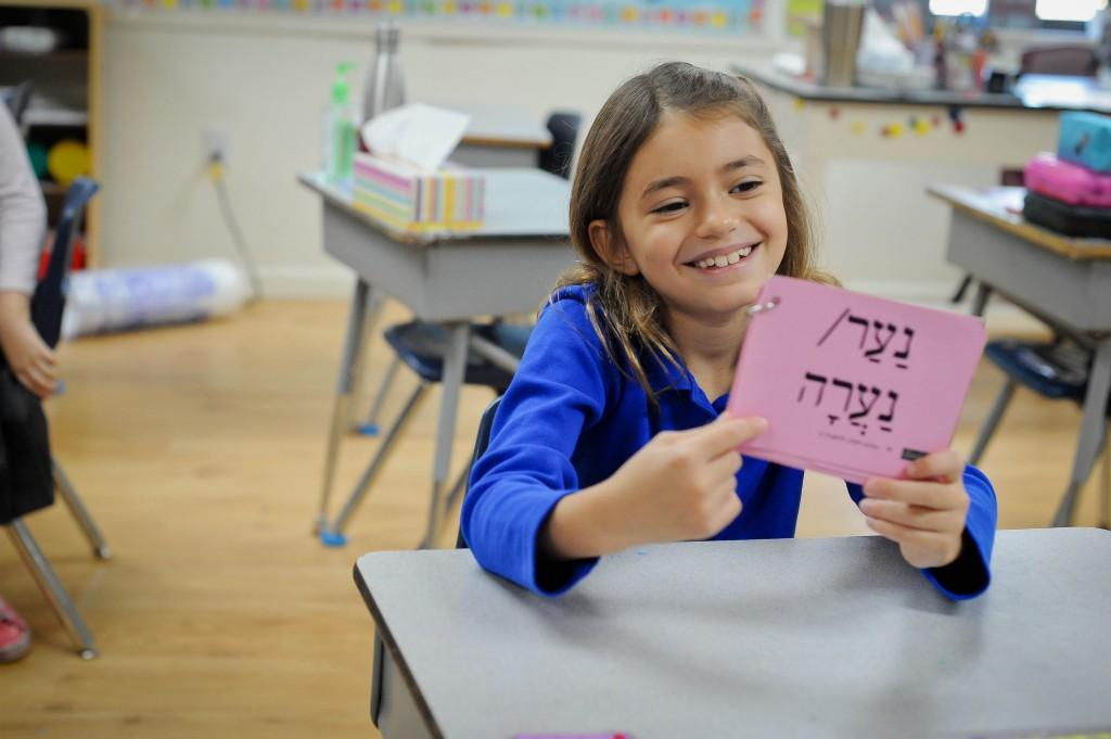 girl studying hebrew words