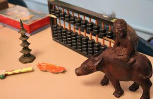 """Photo of Chinese artifacts.  Chinese artifacts, on loan from the Morris Museum, gave Franklin 2nd graders the chance to learn about Chinese culture during """"China Day"""" on Feb. 21.  The study of China is part of a 2nd grade unit on cultural diversity."""