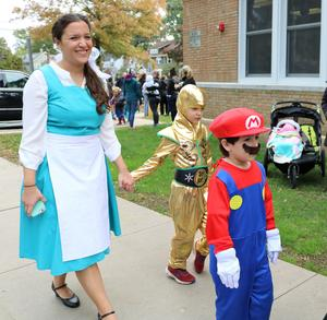 Lincoln School students and staff enjoy showing off their costumes during the Halloween Parade.