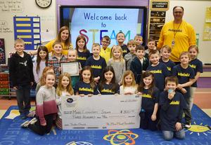 Mars Area Elementary School students, along with STEAM teacher Colleen Hinrichsen and Principal Todd Lape, accept a Mars Planet Foundation Teaching Enrichment Grant on behalf of the District's elementary STEAM program.