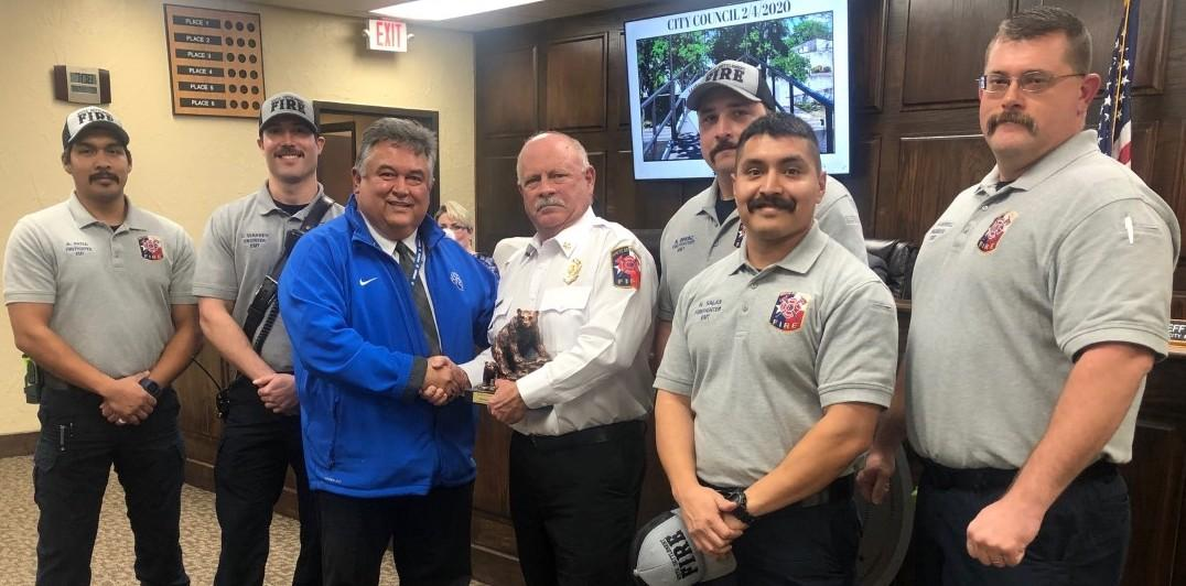 White Settlement ISD Superintendent Frank Molinar recognized White Settlement Fire Chief Mark Ball and his station for continually supporting the district in its community endeavors including the recent BRRRewer Bear Plunge, in which the Swift Water Rescue Team worked.