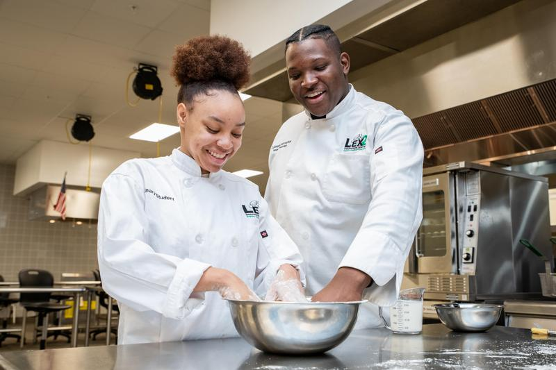 Chef Isaac Pressley, right, leads the culinary arts program