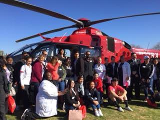Group picture at helicopter