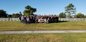 Students, Staff, and Community gather to honor Veterans at the Houston National Cemetery as part of Flags For Our Heroes