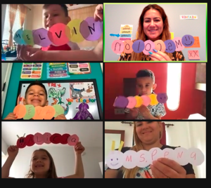 Students holding names written on caterpillars made of paper circles on zoom