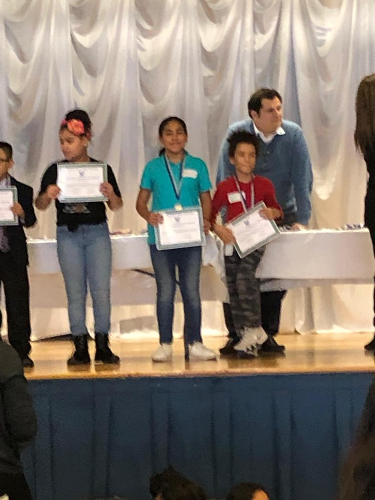 Edison Mia 4th place certificate on stage