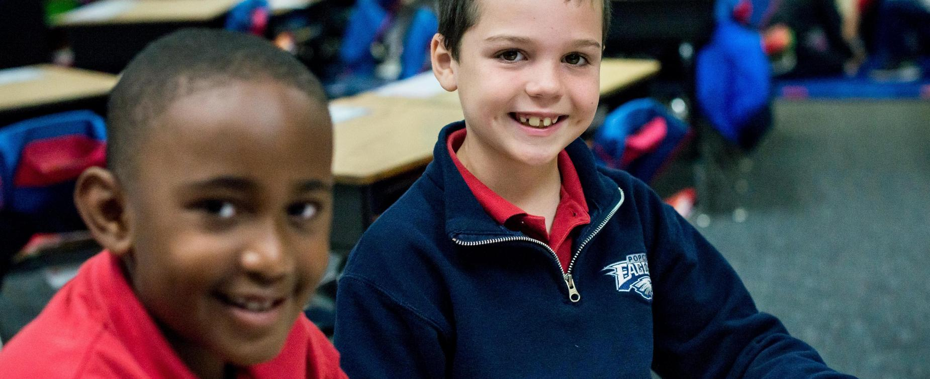 Two Lower School students smiling