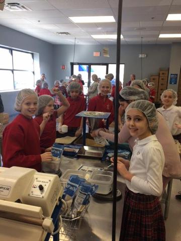 Packing food for Feed My Starving Children