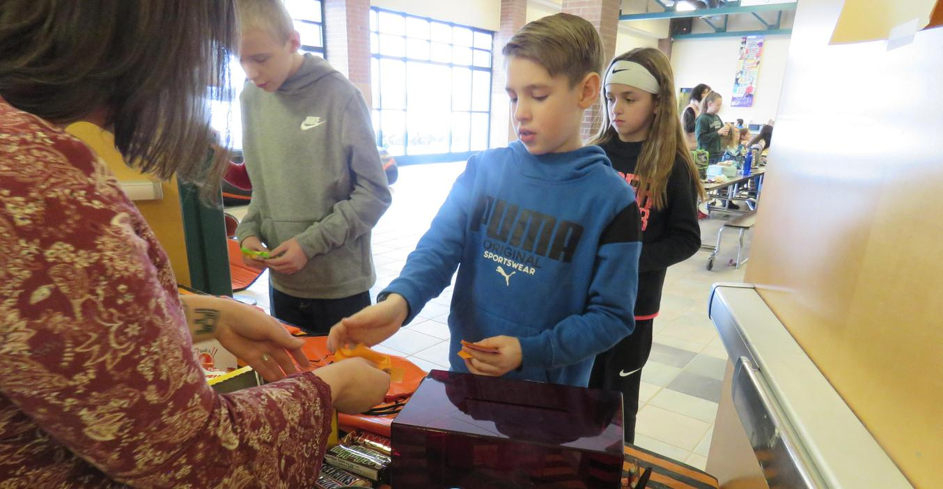 TKMS students enjoy the marketplace at lunch turning in their positive behavior tickets for treats.