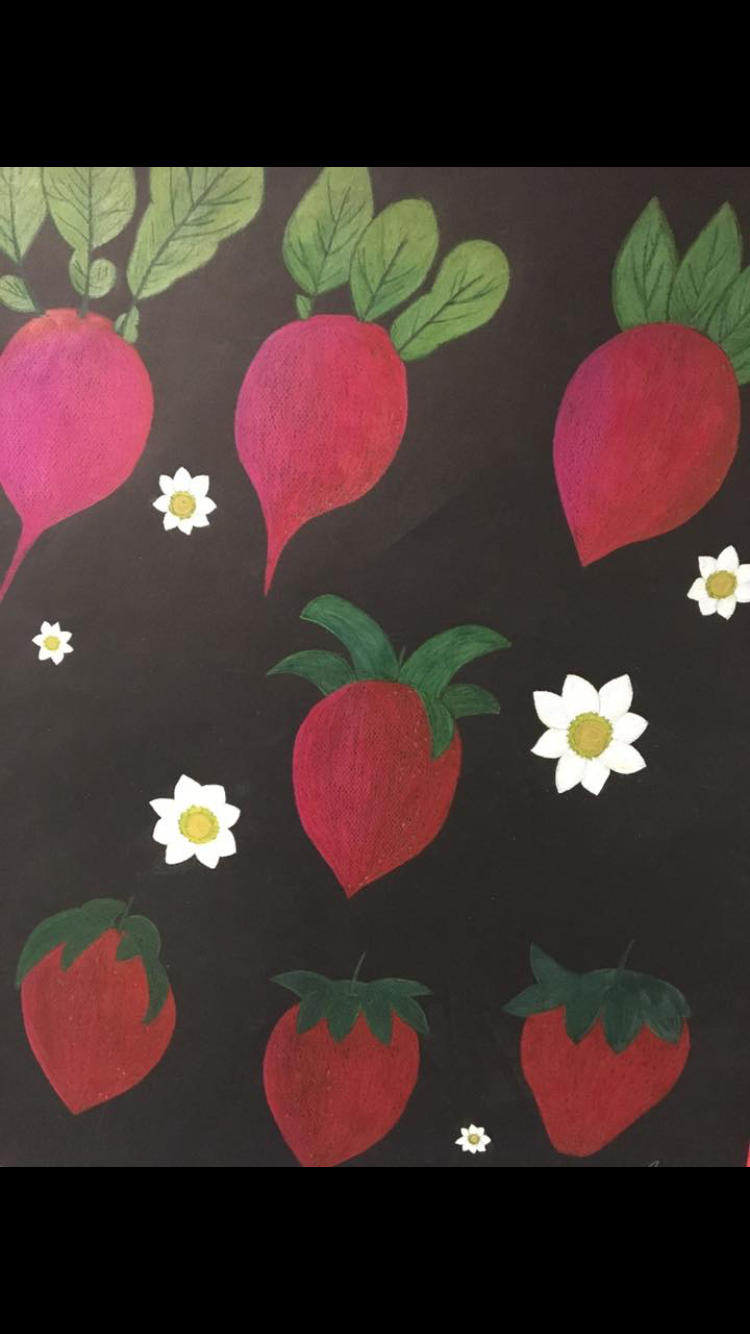 Black paper, red  radish changing into a strawberry
