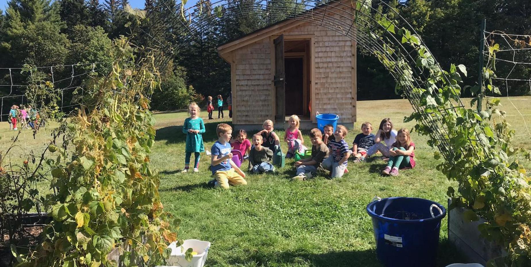 students outside in a garden