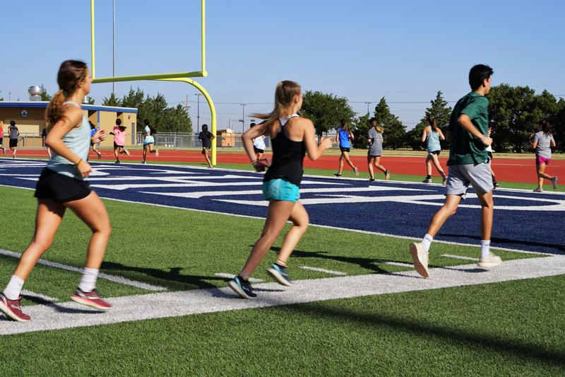 cross country team working out at peoples bank stadium