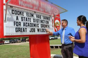 Cooke Elementary administrators announce good news on school marquee