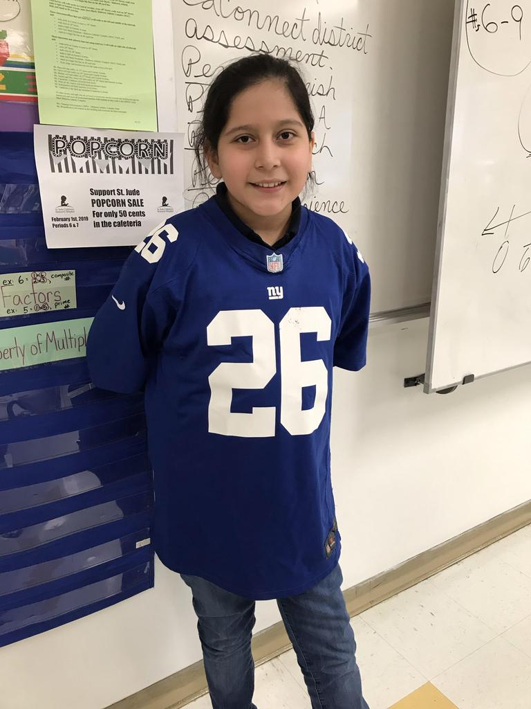 girl wearing giants jersey