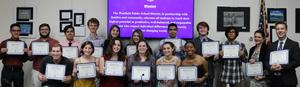 Photo of Westfield High School chorus members and their instructors holding Certificates of Recognition at May 21 Board of Education meeting.