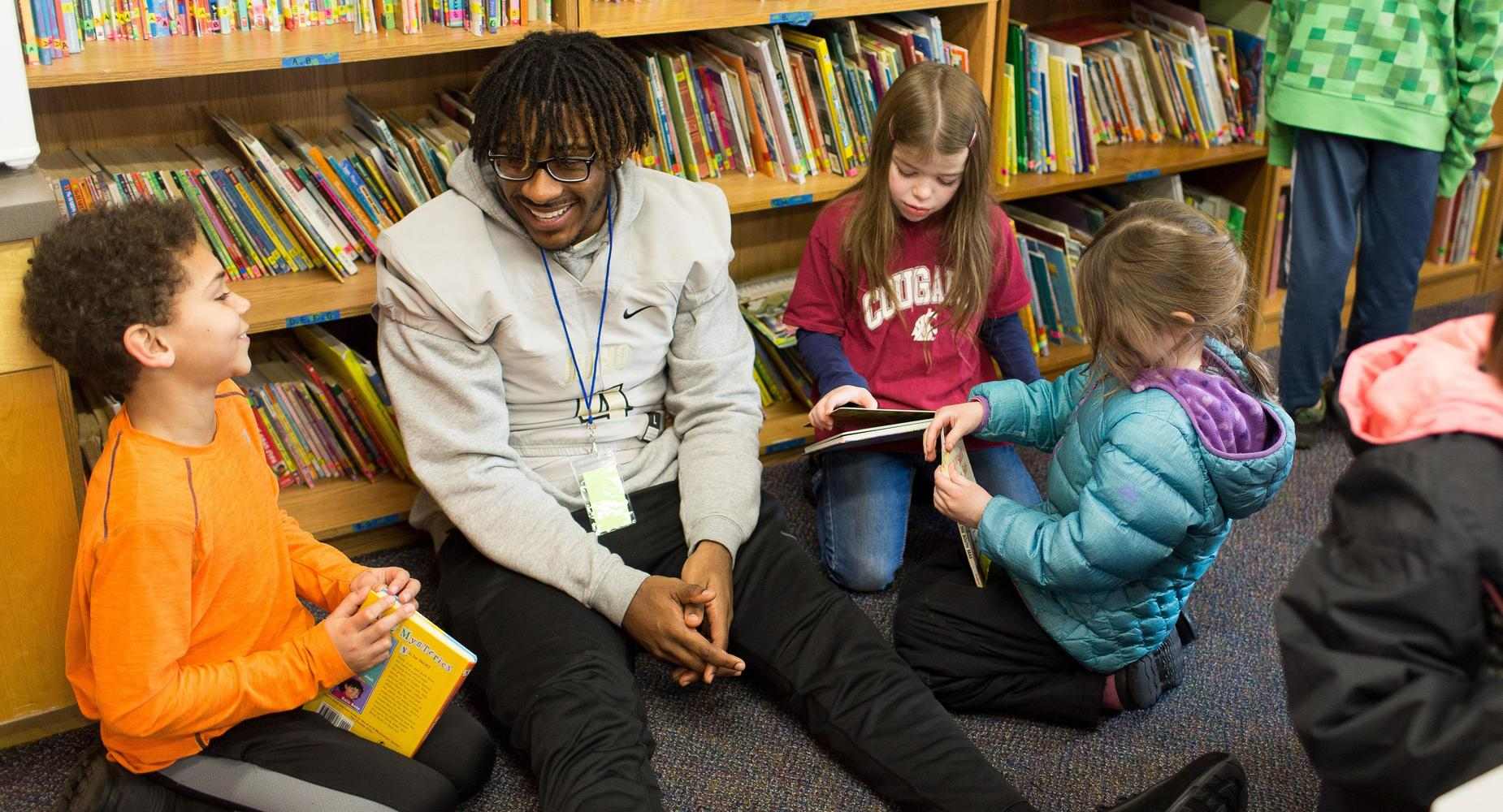Moscow Charter School holds a Book A Bunga day, University of Idaho Football students read to the students