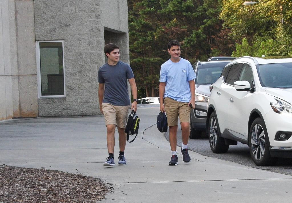 Two young men arrive for the first day of school at Wilkes Early College High School.