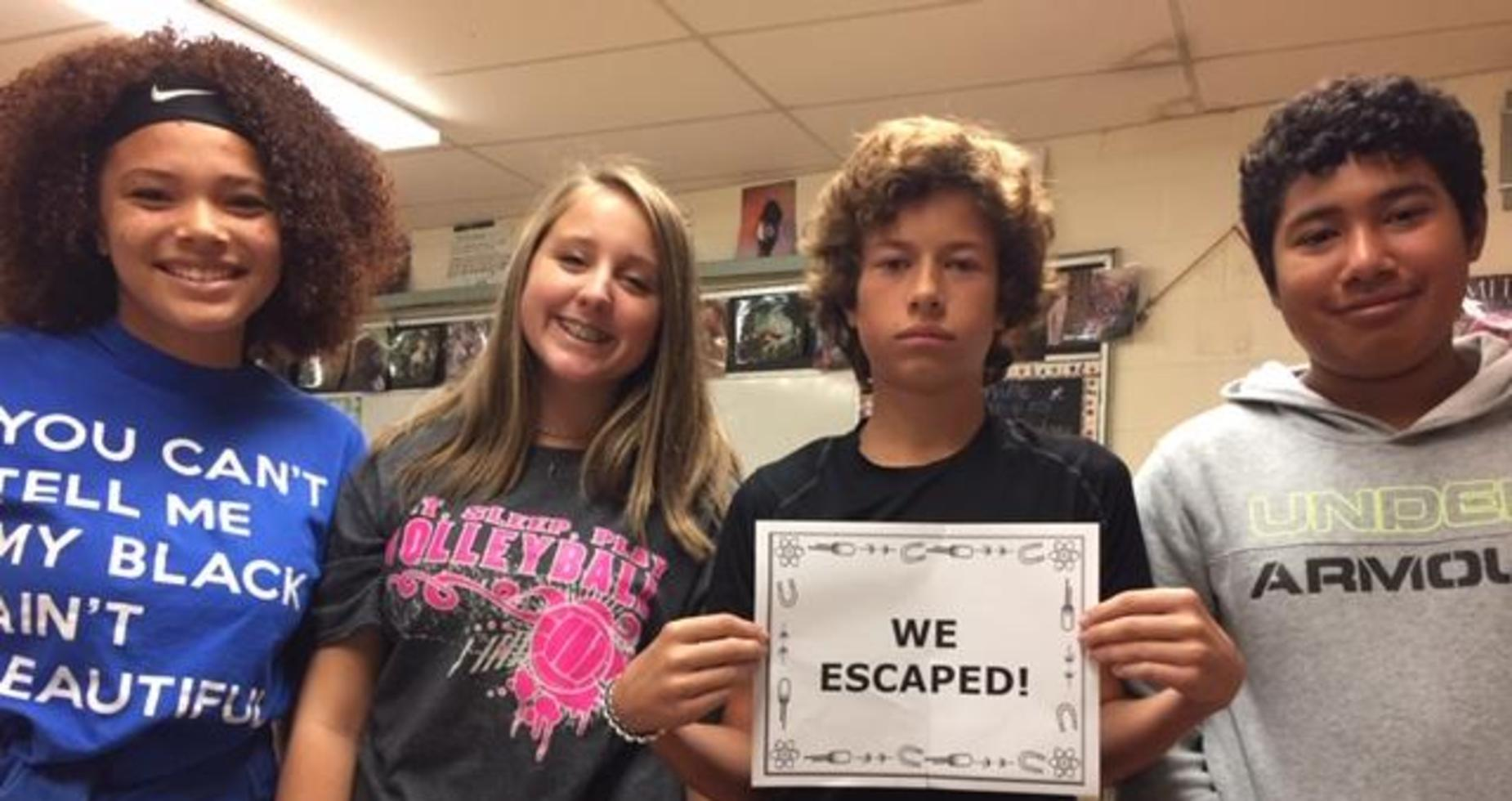 a picture of 4 students who made it out of the escape room