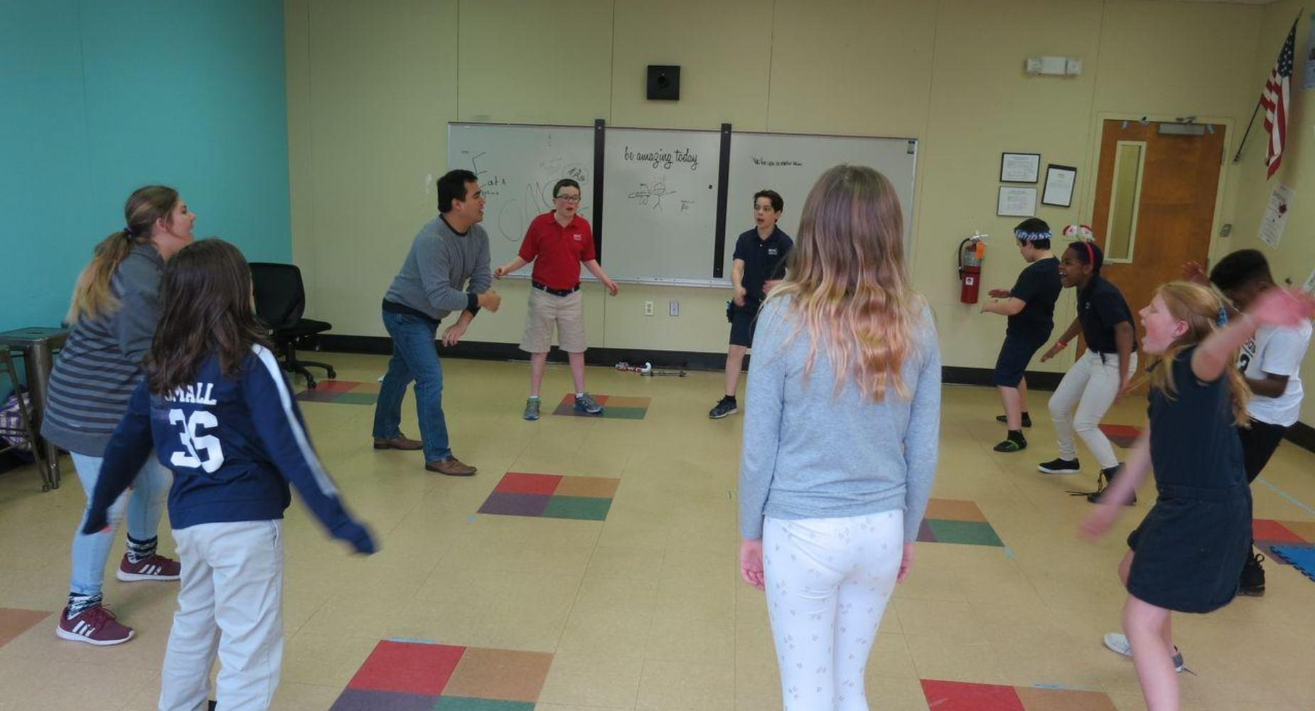 Theatre students playing a game