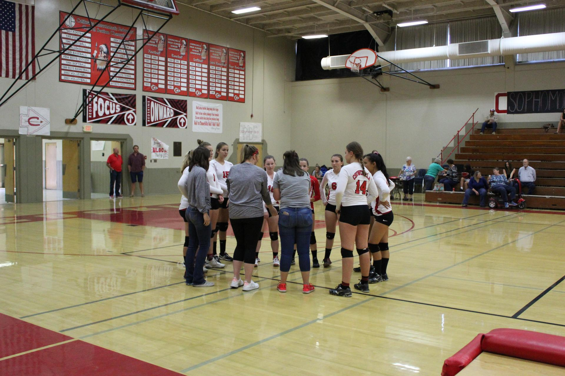 JV Girls playing volleyball against Yosemite