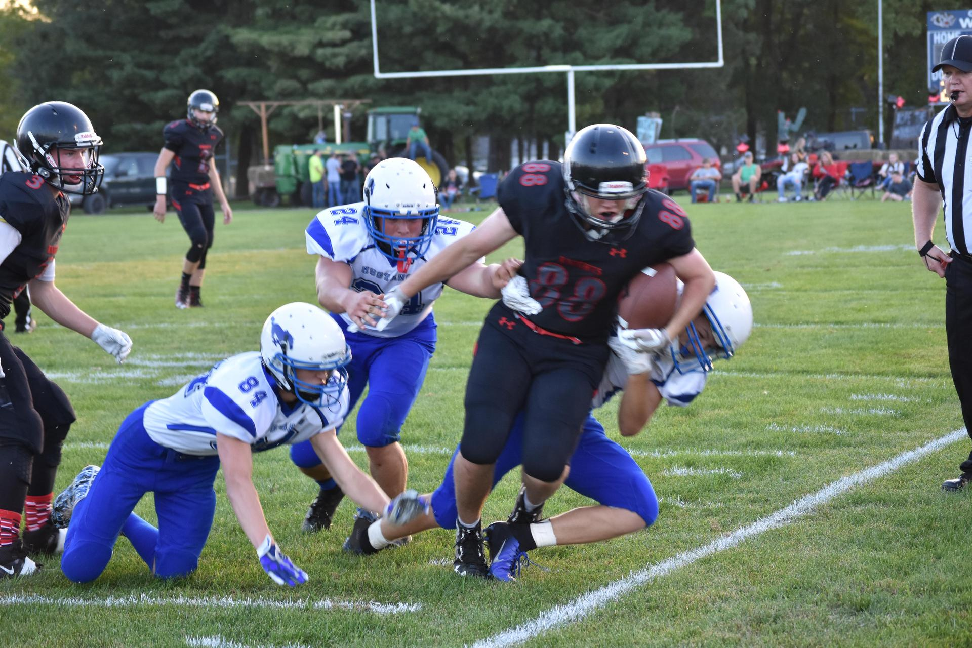 Football player being tackled