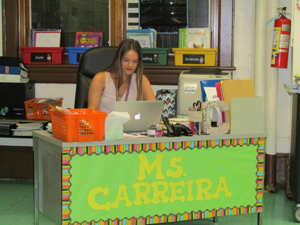 Ms. carreira waiting for parents at her desk